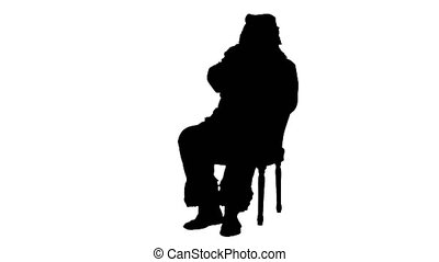 Silhouette Santa Claus sitting on chair with letters in hands