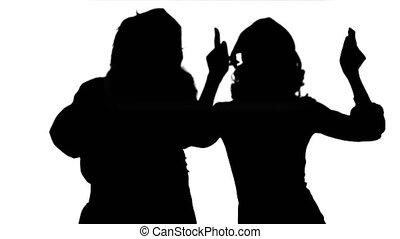 Silhouette Santa claus with beautiful dancing girl