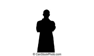 Silhouette Serious medical worker standing with his arms across his chest