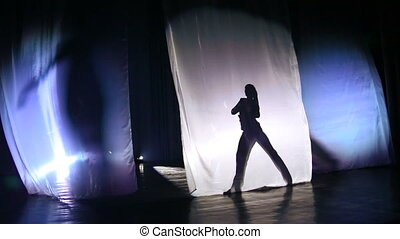 Silhouette, shadow dancing girls on stage.