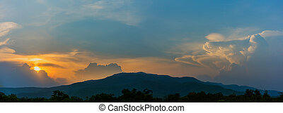 mountain and sunset sky in background