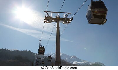 gondola lift - Silhouette shot of a gondola lift against the...