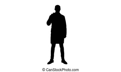 Silhouette Smiling doctor in white coat pointing at medicine bottle and looking at camera