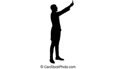 Silhouette Smiling doctor in white coat taking selfie on his phone