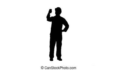 Silhouette Smiling man in helmet make selfie track matte....