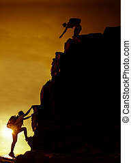 Silhouette sporty woman on the cliff.