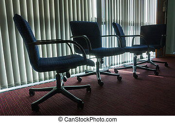Silhouette Styled Of Four Empty Chairs In Office With Blind Back