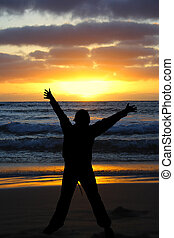 Silhouette sunset - Person arms stretched with sunset