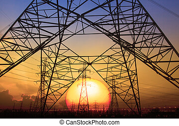 silhouette sunset scene of high voltage electrical pole structure use for electricity generator thermal industry background