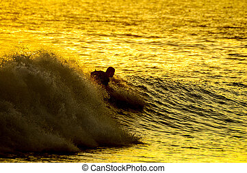 Silhouette Surfer at Sunset