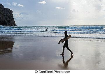 Silhouette surfer beach surfboard Portugal