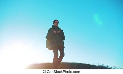 Silhouette teen boy hikerof backpacker. steadicam motion video sunlight sunset person side view walking toward successful. lonely teenager boy with sunset background lifestyle . Travel and success concept the adventure