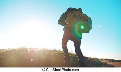 Silhouette teen boy hikerof backpacker. steadicam motion...