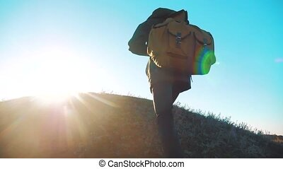 Silhouette teen boy hikerof backpacker. steadicam motion video sunlight sunset person side view walking toward successful. lonely teenager boy with sunset background. Travel and success concept lifestyle the adventure
