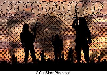 silhouette, terroristen, bei, der, umrandungen, zaun