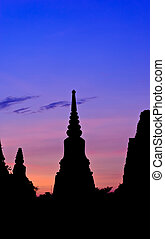 Silhouette Thai pagoda at sunset
