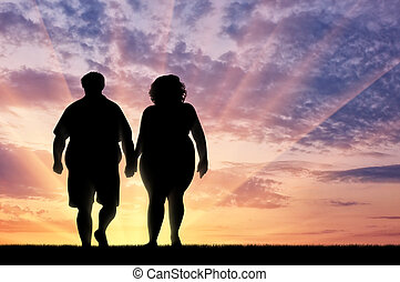 Silhouette thick pair sunset - Couple with overweight on...