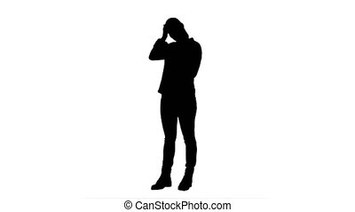 Silhouette Tired working young woman reading messages on the phone.