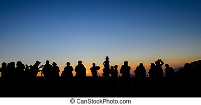 Silhouette tourists with beautiful sunrise