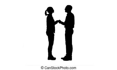 Silhouette Two young people shake hands keep silent. 076s....