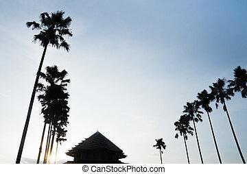 silhouette, van, moskee, en, palmbomen, op, blauwe hemel