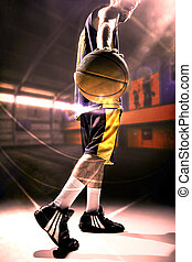 Silhouette view of a basketball player holding basket ball