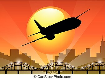Silhouette view of airplane flying over the city