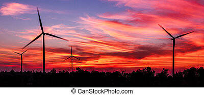 silhouette wind turbine with dusk clean energy concept