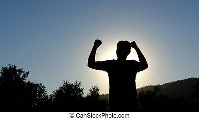 Silhouette winner celebration victory man