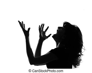 portrait silhouette in shadow of a young woman screaming anger in studio on white background isolated