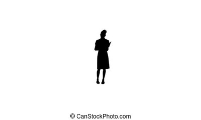 Silhouette woman holding a notepad - A silhouette woman is...