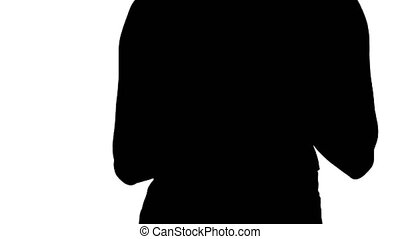 Silhouette Woman holding digital tablet and using it while...