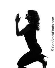 silhouette woman kneel praying imploring