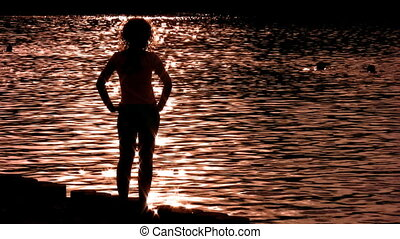 silhouette woman on water alone