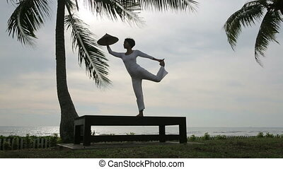 silhouette yoga meditation at beach
