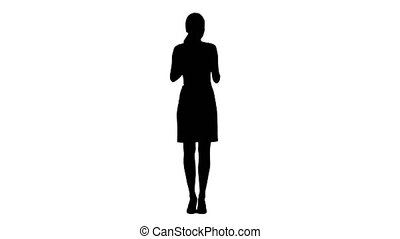 Silhouette Young adult woman applying lipstick herself