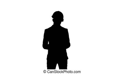 Silhouette Young architect in helmet holding tablet and showing thumb up