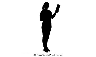 Silhouette Young businesswoman have a video chat on tablet computer.
