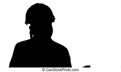 Silhouette Young female construction engineer smiling while have a video conference with laptop.
