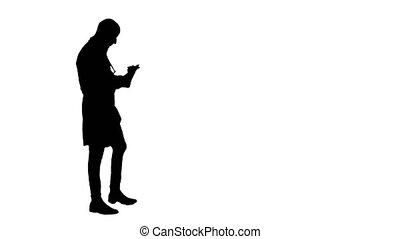 Silhouette Young male doctor using digital tablet