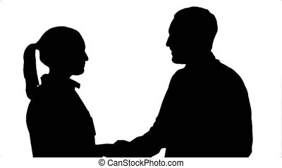Silhouette Young man doctor and beautiful nurse shaking hands after successful operation and looking at camera.