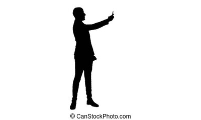 Silhouette Young man in suit taking selfies on the phone....