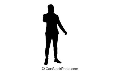 Silhouette Young man in suit talking on the phone and actively gesturing