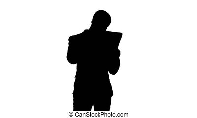 Silhouette Young man in suit talking on the phone and holding papers