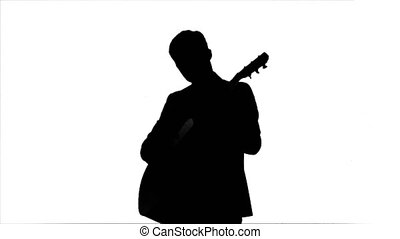 Silhouette Young man playing guitar
