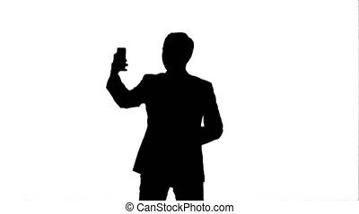 Silhouette Young man taking a selfie photo with his smartphone