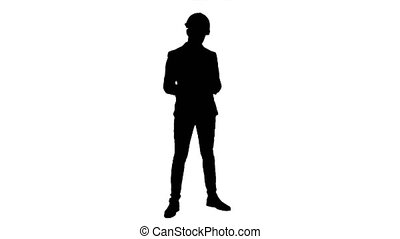 Silhouette Young manager in helmet holding tablet and showing thumb up