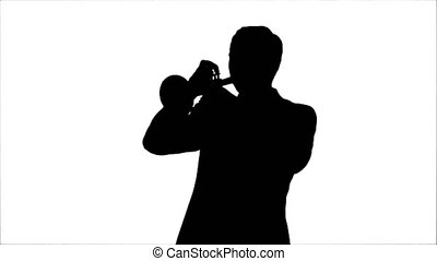 Silhouette Young musician playing trumpet. Professional shot...