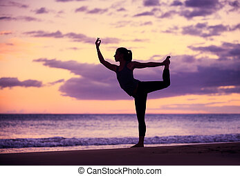 woman practicing yoga - Silhouette young woman practicing...