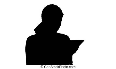 Silhouette Young woman using a tablet